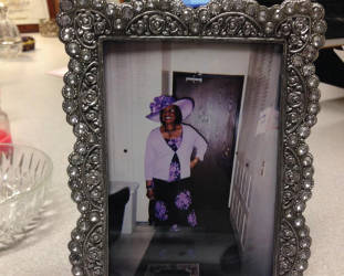 A framed photo sits on Washington-Murray's desk. It shows her mother, Sylvia Washington, dressed in her favorite color, purple. Photo by Dylan Deprey.