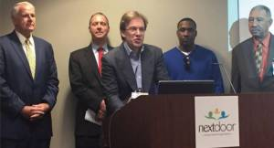 From left to right, Mayor Tom Barrett, Child Support Services Director Jim Sullivan, County Executive Chris Abele, Khalid Crockerhan, and My Father's House Inc. President and CEO Albert Holmes. Photo by Ariele Vaccaro.