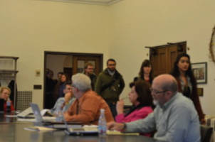 AAUP members walk into the room. Photo by Geoffrey Marshall.