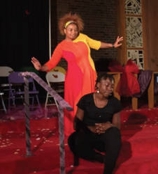 Selena McKnight plays a young girl struggling in the aftermath of molestation. Pam McFarling performs a dance onstage beside her. Photo by Ariele Vaccaro.