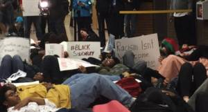 UWM students lay down in protest of violence toward Blacks during a Thursday rally. Photo by Ariele Vaccaro.