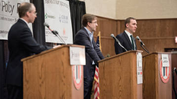 Public Policy Forum President Rob Henken (left) moderates the first Milwaukee County Executive debate between Inc. Chris Abele (middle) and Senator Chris Larsen. Photo by LJL Photo.