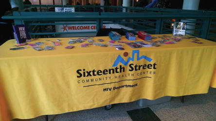 Sixteenth Street Community Health Center table offers free condoms and information about clinic services. Photo By Mrinal Gokhale