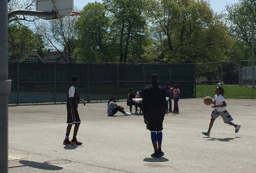 Kids practicing for the 3-on-3 tournament happing outside of the Mary Ryan Boys and Girls club on Milwaukee's north side. Photo by Dylan Deprey
