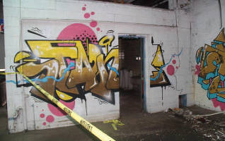 The abandoned Citation factory a block North of N. 27th St. and W. Capital St. being torn down is a hotbed for crime and tattooed in graffiti.