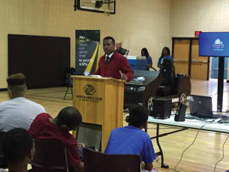 Anthony LaPoint of the Boys and Girls Club asks students to take the pledge to not text and drive. Photo by Dylan Deprey