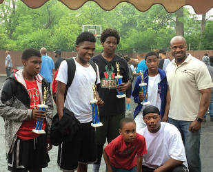 Teams from around the city competed in the 3-on-3 basketball tournament. (Photo By Dylan Deprey)