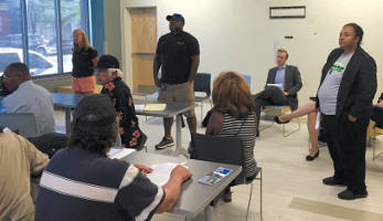 Ald. Milele Coggs held a neighborhood meeting Monday July 23, to receive community input on the city's potential building sale to Right Step Inc. (Photo by Dylan Deprey)