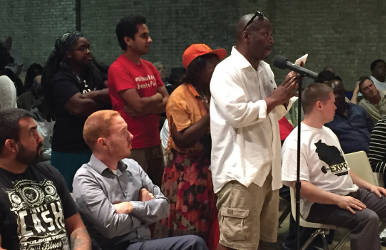 Community members could ask questions to panel members about life after prison and other topics. (Photo By Dylan Deprey)