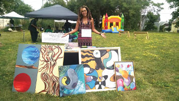 Madia Norton sells her artwork while also promoting the Teen Pregnancy Prevention Program. (Photo by Mrinal Gokhale)