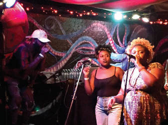 "Klassik, Kyndal J, and B Free handle vocals during the ""Coronation"" release party. (Photo by Dylan Deprey)"