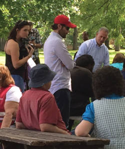 Feingold speaking with community members at Sherman Park Barbeque. (Photo by Karen Stokes)