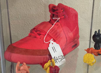 "The limited pair of AIR Yeezy 2 SP ""Red October"" are the most expensive shoe at Trusted Kicks running at $4,500. (Photo by Dylan Deprey)"