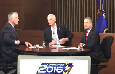 """Moderator Mike Gousha, Sen. Ron Johnson and Russ Feingold have a 90 minute """"conversation"""" during the WISN and Marquette Law School senate debate. (Photo by Dylan Deprey)"""