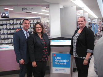 Walgreens drop box at the Walgreens at 35th & Wisconsin. Amber Meyer Smith, Director of Government Affairs for Clean Wisconsin, Kari Lerch, Director of the Community Advocates Public Policy Institute, and Nick Sinclair of Walgreens.