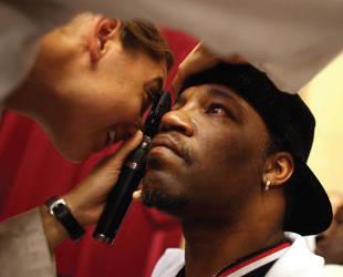Man having eyes examined
