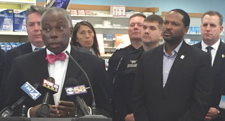 Milwaukee Health Commissioner Bevan Baker gives his thanks during the Drug Mail Back Program announcement Dec. 1, 2016. (Photo by Dylan Deprey)