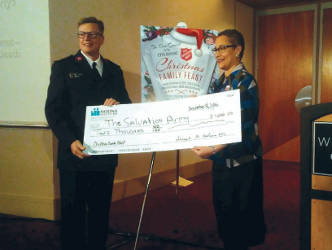 Molina Healthcare awards $2,000.00 to Christmas Family Feast of The Salvation Army. (Photo by Mrinal Gokhale)