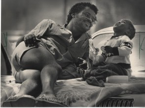 It was a father-daughter afternoon Wednesday for Ron Barki and his 2-year-old Vana. The father watched the daughter as she watched birds overheard. The two were sitting on a towel in a parking lot at Bradford Beach. Thursday, July 24, 1986.