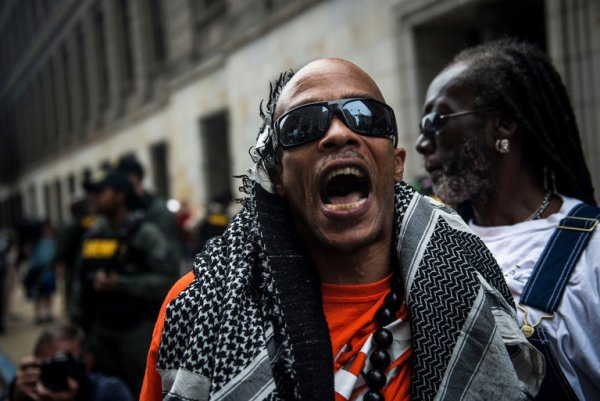 A protester shouted at the police in Baltimore on Thursday after an officer was acquitted of all seven charges against him in the Freddie Gray case.