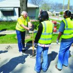 Mayor Barret Helps fill potholes