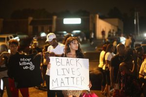 Peaceful protesters rally for justice in Ferguson.