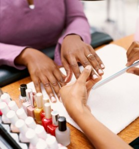 Close-up of a woman having her manicure done