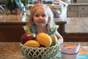 Mangoes and little girl