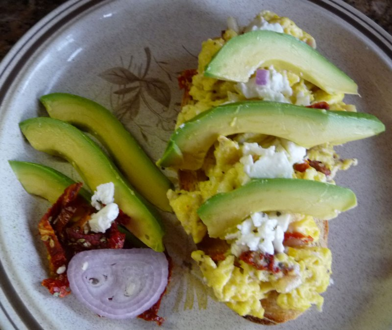 Scramble on Toast with Avocados, Sundried Tomatoes and Feta