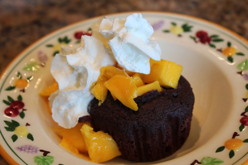 mangoes with whipped cream in avocado chocolate cupcakes