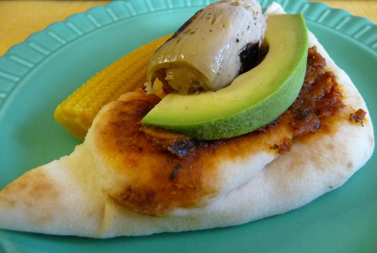 avocado and grilled artichoke heart on bruschetta