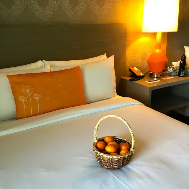 Tango mandarin oranges on the bed at Beverly Garland Hotel in N. Hollywood, CA