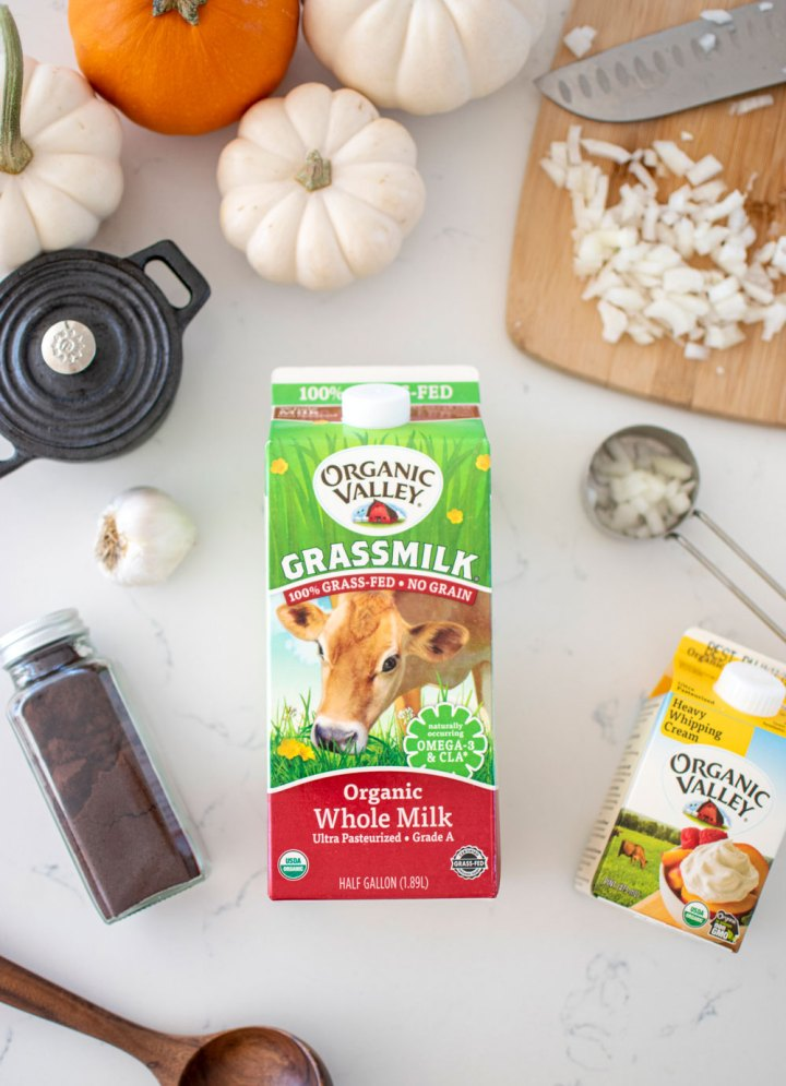 Easy and delicious Creamy Spiced Pumpkin Soup recipe. This fall soup recipe is sure to impress, made with Organic Valley Milk and Heavy Whipping Cream, this creamy soup is something you'll want to make for dinner this fall #fall #soup #fallsoup #creamysoup #pumpkinsoup #pumpkinspice #pumpkinspicesoup #organicsoup #heartysoup