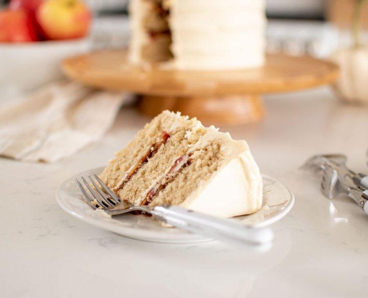Easy and delicious recipe for Apple Cinnamon Honey Cake, the perfect fall inspired cake! This healthy cake uses fresh in season apples to make an apple pie like filling. It's frosted with a honey buttercream for a cake that would be the perfect addition to your Thanksgiving menu #thanksgiving #thanksgivingcake #cake #organic #organiccake #highaltitudebaking #applecinnamon #honey #cinnamonhoney