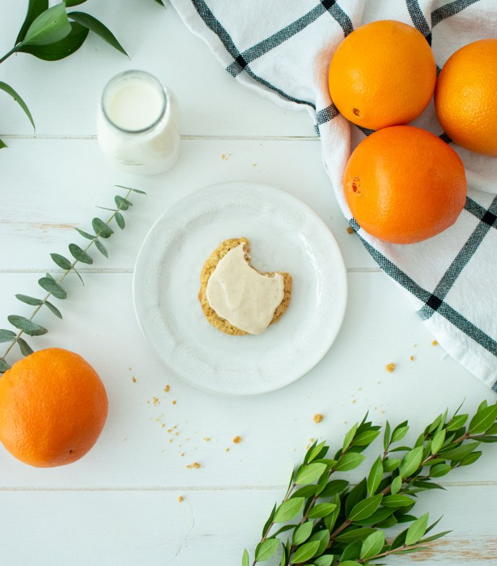 Delightfully easy Brown Butter Glazed Orange Cardamom Cookies. This light and delicious cookie recipe is different but oh so amazing! Perfect cookie recipe for Easter or anytime of year #organiccookies #organiccookierecipe #organicrecipe #cookierecipe #cookierecipes #orangecardamom #brownbutter #highaltitudebaking #highaltitude #glazedcookies #glaze