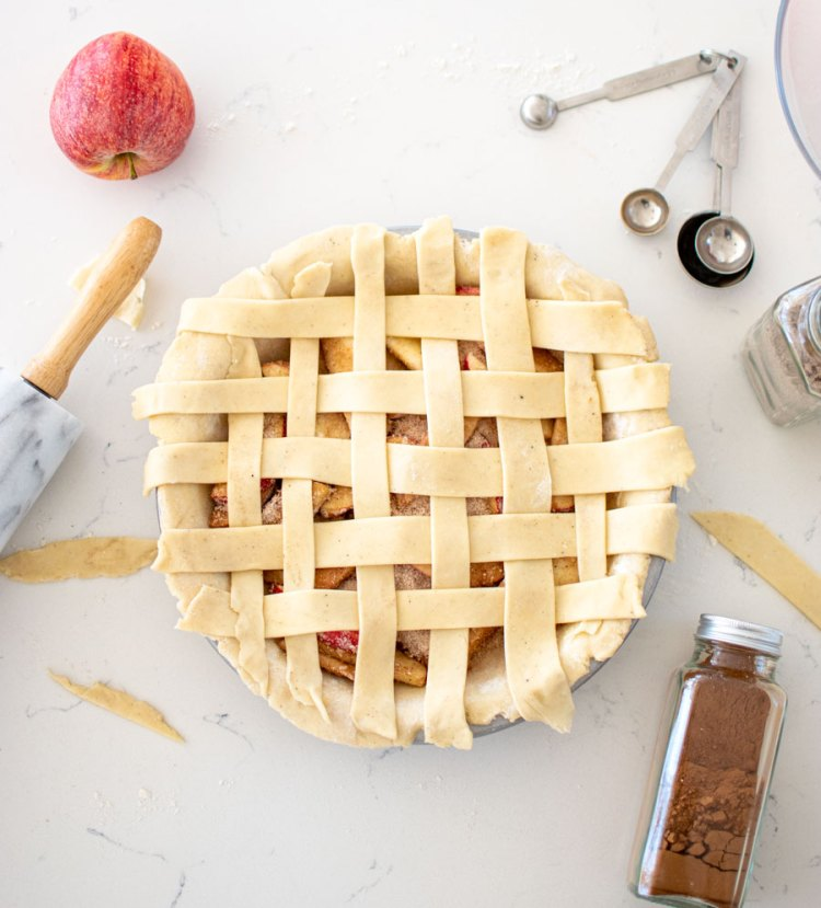 Classic Apple Pie with a twist, this Cardamom Apple Pie is perfect for Thanksgiving! This high altitude apple pie recipe will bake up perfect at sea level too! Using USA Pan Pie Pan, this apple pie does not stick to the pan and will make Thanksgiving dessert complete #highaltitudebaking #pie #applepie #thanksgiving #usapan #fall #fallbaking
