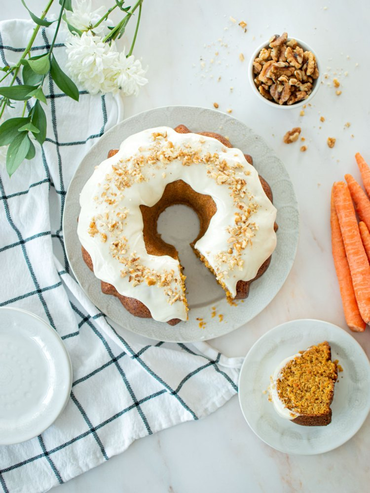Easy Carrot Bundt Cake with Cream Cheese Icing recipe. Get this healthy and delicious Carrot Bundt Cake recipe with Cream Cheese Icing. Plus, get my trick for the easiest bundt cake removal. The best hack to remove bundt cake perfectly every single time! #organiccake #carrotcake #creamcheesefrosting #bundtcake #eastercake #caketricks #caketips #cakeremovalhack #bakingtips #bakinghacks #bakingtricks