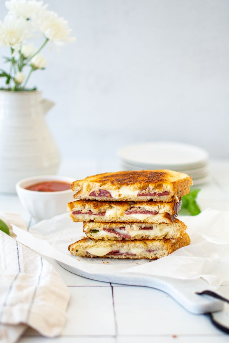 Easy Pepperoni Pizza Grilled Cheese recipe with parmesan and dipping sauce. This easy grilled cheese recipe will elevate your traditional grilled cheese with the comforting flavor pizza! #pizza #pizzagrilledcheese #grilledcheese #easygrilledcheese