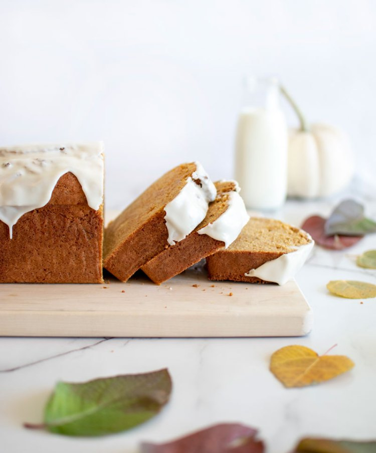 The best holiday loaf cake recipe! Spiced Sweet Potato Loaf Cake is an easy recipe that will impress your friends and family this holiday season. This recipe uses raw sweet potatoes, warm and cozy spices, and is topped with a sweet glaze! #holidayreicpes #sweetpotato #loafcake #cake #organic #organiccake #glutenfree #glutenfreecake #spiced #spicedcake #highaltitudebaking #christmasreipce #christmas #thanksgiving #thanksgivingrecipe
