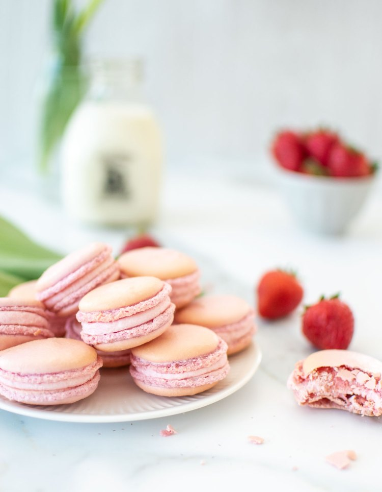 Traditional Strawberry French Macaron recipe using natural dyes, no artificial colors. These naturally gluten free cookies are the perfect combination of crispy, chewy, and melt in your mouth delicious! French macaron tips and tricks so you can make the best French macarons in your own kitchen. High altitude recipe for Strawberry French Macarons. #noartificialcolors #naturallycolored #strawberrycookies #strawberryfrenchmacarons #organicfrenchmacarons #frenchmacarons #macarons