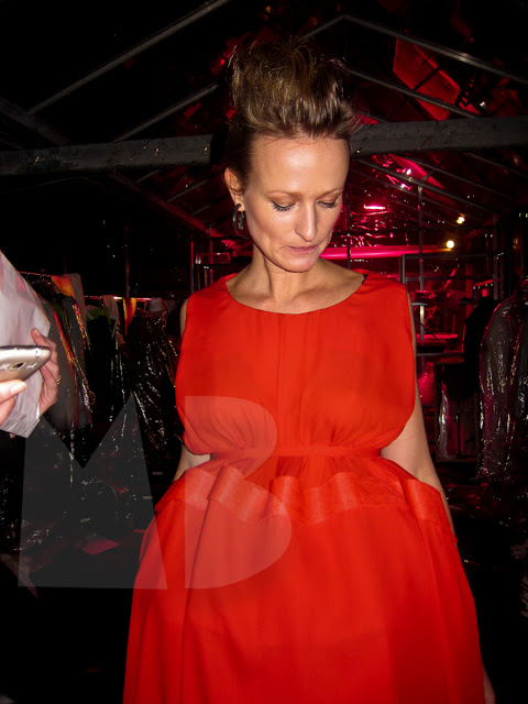 Kim Vos trying on her outfit for the opening night of the amsterdam fashion week.