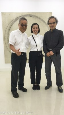 Akio Igarashi and company in front of his work