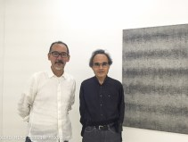 Akio Igarashi and Takashi Suzuki in front of Akio Igarashi 's work