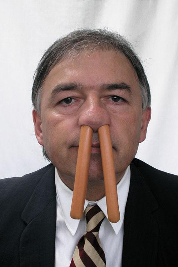 Joël Hubaut with hotdogs in his nose.