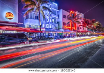 stock-photo-miami-florida-january-cars-speed-down-ocean-drive-the-road-is-the-main-thoroughfare-180027140
