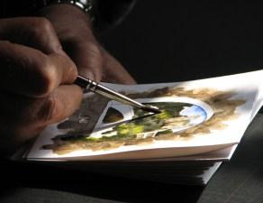 Dolceacqua43_-_Artista_locale_mentre_dipinge_un_acquarello-1024x768