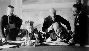 Monsignor Francesco Borgongini-Duca, Cardinal Pietro Gasparri, Francesco Pacelli, Benito Mussolini, and Dino Grandi at the signing of the Lateran Treaty between Italy and the Vatican, February 1929