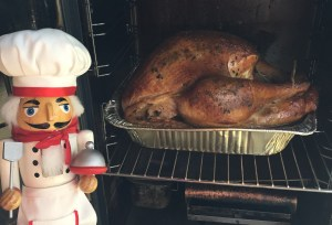 Pepe checking the turkey while it smokes