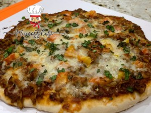 Sausage and chanterelle cheesy pizza.