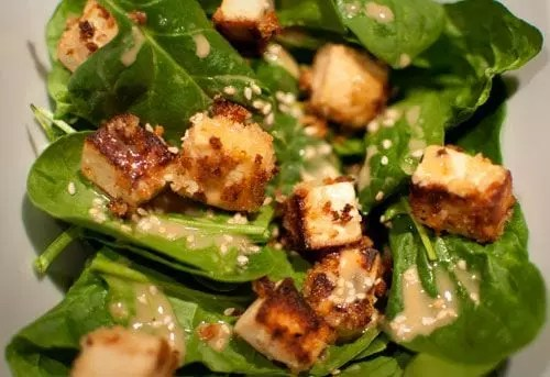 Closeup of the Crispy Panko Tofu Salad on Baby Spinach with Glory Bowl Dressing